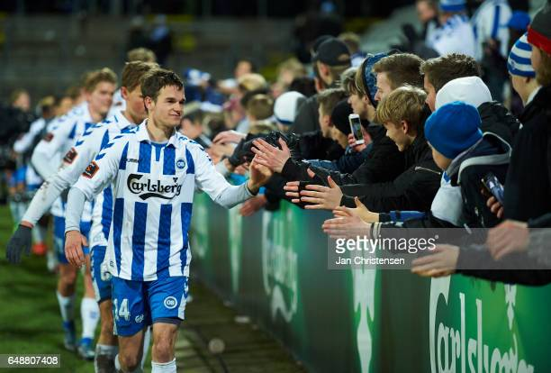 Jens Jakob Thomasen of OB Odense teammates and fans of OB Odense celebrates after the Danish Alka Superliga match between OB Odense and AaB Aalborg...