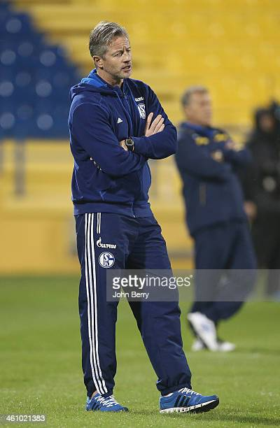Jens Keller coach of Schalke looks on during the friendly match between Al Gharafa SC and Schalke 04 at the Al Gharafa Stadium on January 6 2014 in...