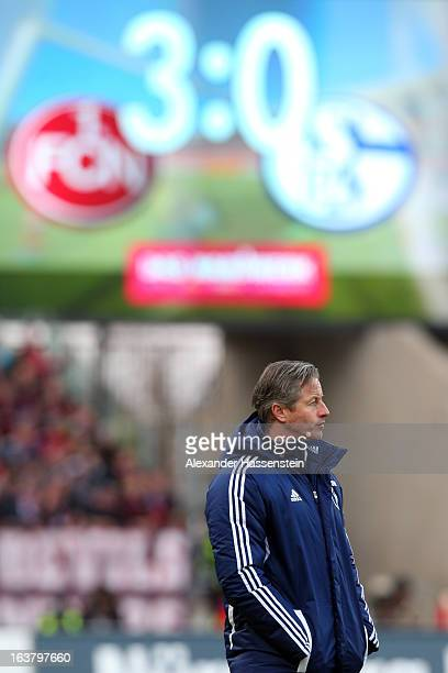 Jens Keller head coach of Schalke looks on during the Bundesliga match between 1 FC Nuernberg and FC Schalke 04 at GrundigStadion on March 16 2013 in...