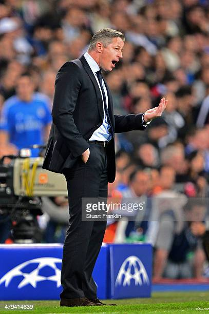 Jens Keller the Schalke manager directs his players during the UEFA Champions League Round of 16 second leg match between Real Madrid and FC Schalke...
