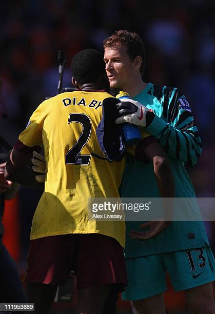 Jens Lehman of Arsenal congratulates Abou Diaby after the Barclays Premier League match between Blackpool and Arsenal at Bloomfield Road on April 10...