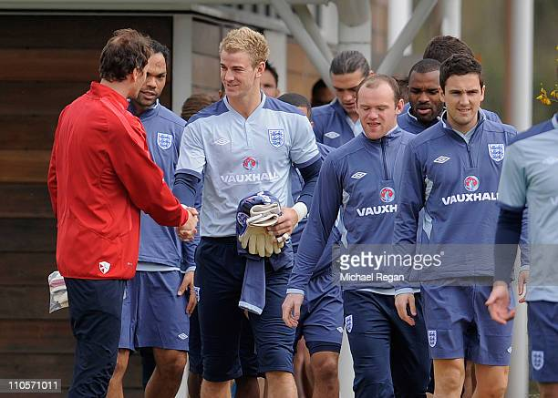 Jens Lehman of Arsenal greets Joe Hart of England during the England training session ahead of their UEFA EURO 2012 qualifier against Wales at London...