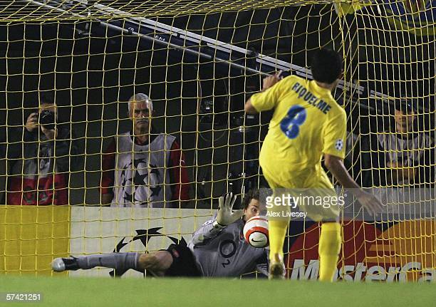 Jens Lehman of Arsenal saves a penalty kick from Riquelme of Villarreal during the UEFA Champions League Semi Final second leg match between...