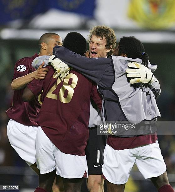 Jens Lehmann of Arsenal celebrates with Kolo Toure at the end of the UEFA Champions League semifinal second leg match between Arsenal and Villarreal...