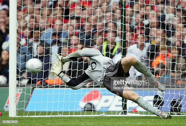 Jens Lehmann of Arsenal saves the shot by Paul Scholes during the FA Cup Final between Arsenal and Manchester United penalty shootout at The...