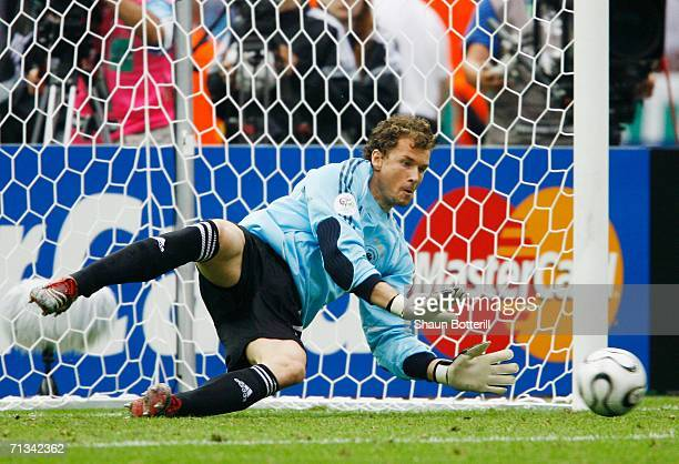 Jens Lehmann of Germany dives to save a penalty taken by Roberto Ayala of Argentina in a penalty shootout during the FIFA World Cup Germany 2006...