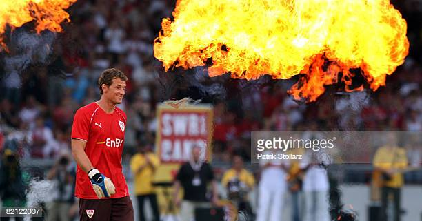 Jens Lehmann of Stuttgart walks into the stadium through fireworks prior to a pre season friendly match between VfB Stuttgart and Arsenal London on...