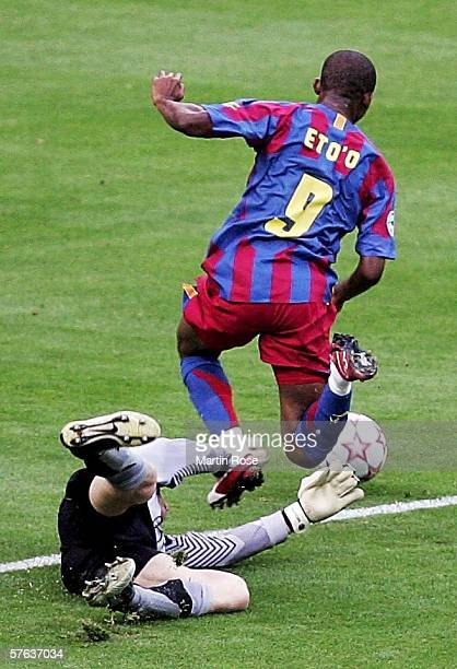 Jens Lehmann the Arsenal goalkeeper challenges Samuel Eto'o of Barcelona during the UEFA Champions League Final between Arsenal and Barcelona at the...