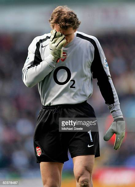 Jens Lehmann the Arsenal goalkeeper holds his face after El Hadji Diouf of Bolton was sent off during the FA Cup Quarter Final match between Bolton...