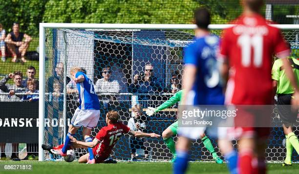 Jens Odgaard of Lyngby BK scores the 30 goal against Mikael Antonsson and Goalkeeper Stephan Andersen of FC Copenhagen during the Danish Alka...