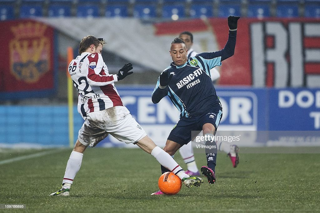 Jens Podevijn of Willem II, Tjaronn Chery of ADO Den Haag during the Dutch Eredivise match between Willem II and ADO Den Haag at the Koning Willem II Stadium on January 20, 2013 in Tilburg, The Netherlands.