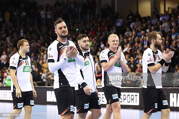 Jens Schoengarth of Germany and his teammates celebrate with fans after the International Handball Friendly match Germany v Romania on January 3 2017...