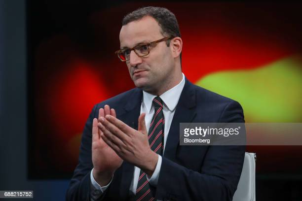 Jens Spahn Germany's deputy finance minister and Christian Democratic Union party member gestures while speaking during a Bloomberg Television...