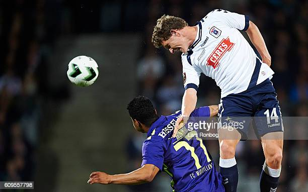 Jens Stage of AGF Aarhus and Bruninho of FC Midtjylland compete for the ball during the Danish Alka Superliga match between AGF Aarhus and FC...