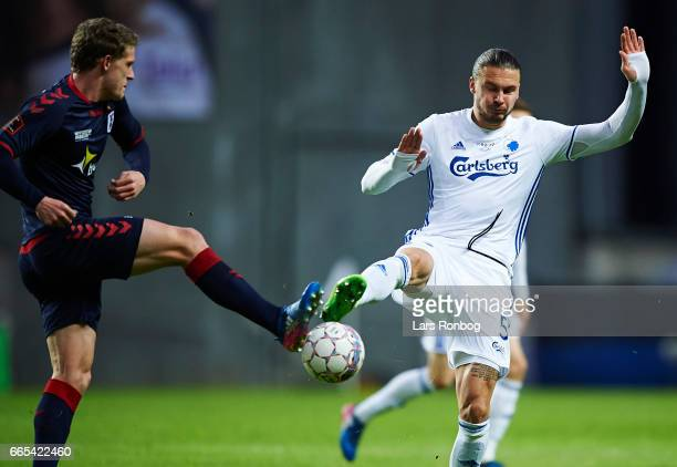 Jens Stage of AGF Aarhus and Erik Johansson of FC Copenhagen compete for the ball during the Danish cup DBU Pokalen quarterfinal match between FC...