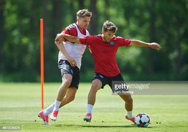 Jens Stryger Larsen and Andrew Hjulsager compete for the ball during the Denmark training session at Brondby Stadion on June 2 2017 in Brondby Denmark