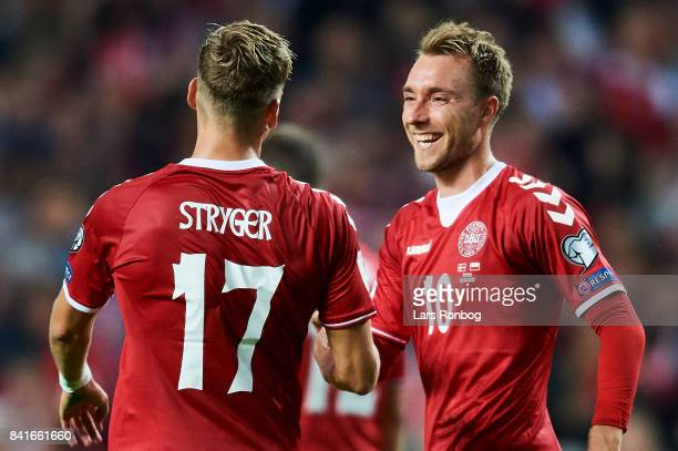 Jens Stryger Larsen and Christian Eriksen of Denmark celebrate after scoring their fourth goal during the FIFA World Cup 2018 qualifier match between...