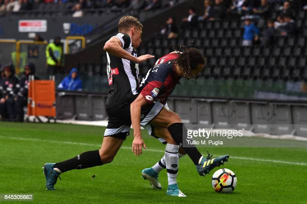 Jens Strygers Larsen of Udinese and Diego Laxalt of Genoa compete for the ball during the Serie A match between Udinese Calcio and Genoa CFC at...