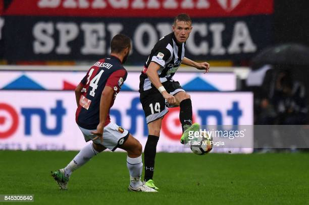 Jens Strygers Larsen of Udinese kicks the ball as Davide Biraschi of Genoa tackles during the Serie A match between Udinese Calcio and Genoa CFC at...