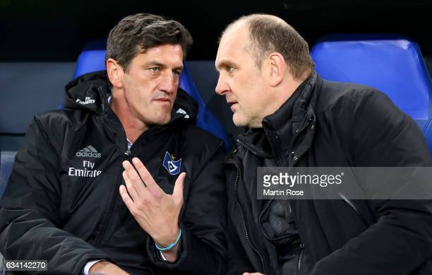 Jens Todt sport director of Hamburg talks to Joerg Schmadtke sport director of Koeln before the DFB Cup round of 16 match between Hamburger SV and 1...