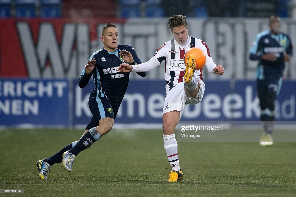 Jens Toornstra of ADO Den Haag, Jordens Peters of Willem II during the Dutch Eredivise match between Willem II and ADO Den Haag at the Koning Willem II Stadium on January 20, 2013 in Tilburg, The Netherlands.