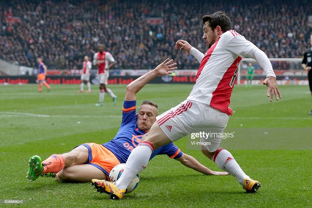 Jens Toornstra of Feyenoord, Amin Younes of Ajax 1-1 during the Dutch Eredivisie match between Ajax Amsterdam and Feyenoord Rotterdam at the Amsterdam Arena on February 07, 2016 in Amsterdam, The Netherlands