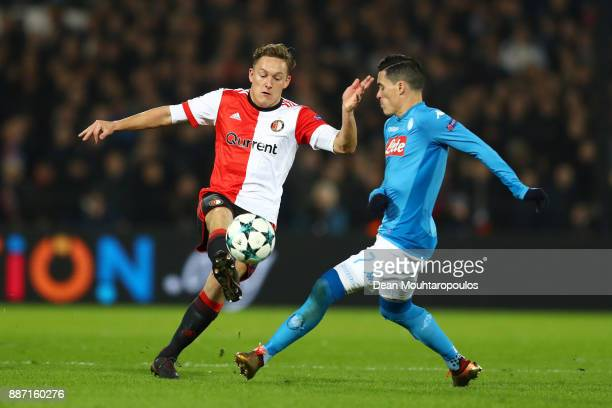 Jens Toornstra of Feyenoord and Jose Callejon of SSC Napoli during the UEFA Champions League group F match between Feyenoord and SSC Napoli at...