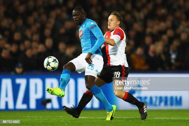 Jens Toornstra of Feyenoord battles for the ball with Kalidou Koulibaly of Napoli during the UEFA Champions League group F match between Feyenoord...