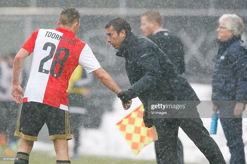 Jens Toornstra of Feyenoord, coach Giovanni van Bronkhorst of Feyenoord during the Dutch Eredivisie match between PEC Zwolle and Feyenoord Rotterdam at the IJsseldelta stadium on February 14, 2016 in Zwolle, The Netherlands