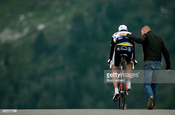 Jens Voigt of Germany and Team CSC makes his way back down the mountain on his bike after losing the yellow jersey and over 30 minutes to Lance...