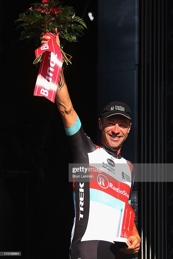 Jens Voigt of Germany and Team Radioshack Leopard celebrates on the podium after winning the Most Combative Rider Prize for stage twenty of the 2013 Tour de France, a 125KM road stage from Annecy to Annecy-Semnoz, on July 20, 2013 in Annecy, France.