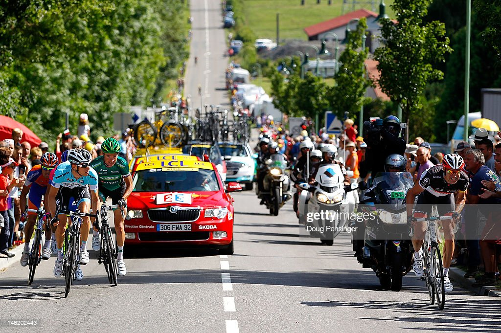 Jens Voigt (R) of Germany riding for Radioshack-Nissan attacks the tete de la course in the final kilometers of stage ten of the 2012 Tour de France from Macon to Bellegarde-Sur-Valserine on July 11, 2012 in Bellegarde-sur-Valserine, France.
