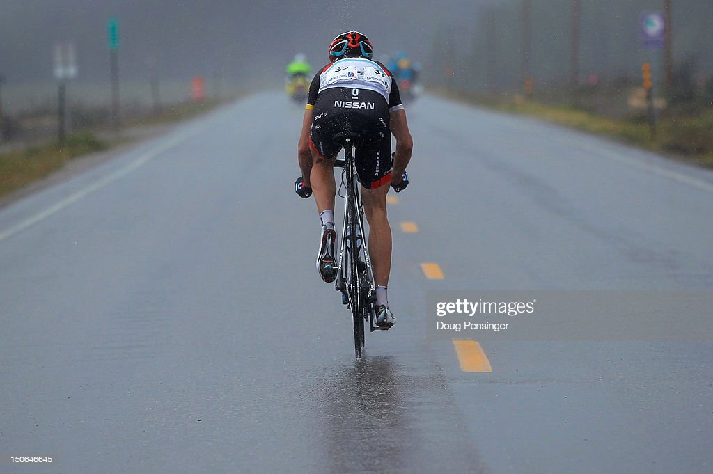 Jens Voigt of Germany riding for Radioshack-Nissan rides through a rain storm as he rides his solo attack to victory in stage four of the USA Pro Challenge from Aspen to Beaver Creek on August 23, 2012 in Leadville, Colorado.