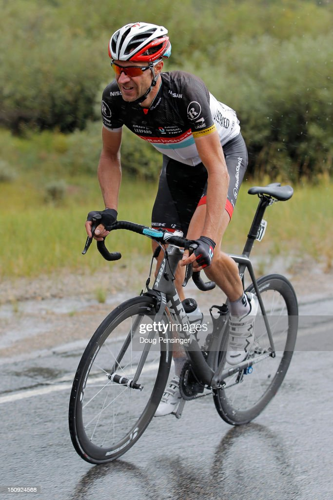 Jens Voigt of Germany riding for Radioshack-Nissan rides through as rain storm en route to a solo breakaway victory in stage four of the USA Pro Challenge from Aspen to Beaver Creek on August 23, 2012 in Leadville, Colorado.