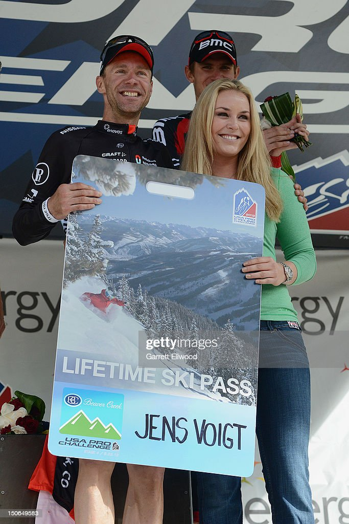 Jens Voigt of Germany riding for RadioShack-Nissan-TREK poses for a photo after being presented with a lifetime ski pass to Beaver Creek from American alpine ski racer Lindsey Vonn following his win of Stage Four of the USA Pro Challenge from Aspen to Beaver Creek on August 23, 2012 in Beaver Creek, Colorado.