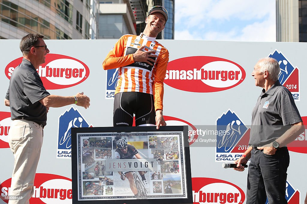 <a gi-track='captionPersonalityLinkClicked' href=/galleries/search?phrase=Jens+Voigt&family=editorial&specificpeople=224836 ng-click='$event.stopPropagation()'>Jens Voigt</a> of Germany riding for Trek Factory Racing celebrates on the podium in the orange most courageous rider jersey after the final stage of the 2014 USA Pro Challenge from Boulder to Denver on August 24, 2014 in Denver, Colorado.
