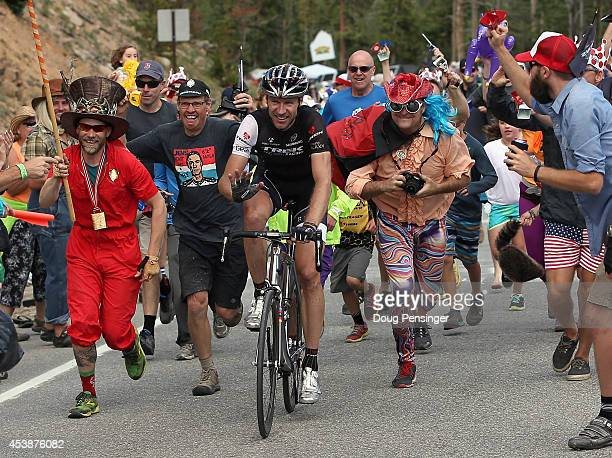 Jens Voigt of Germany riding for Trek Factory Racing is encouraged by fans on the climb to the finish during stage three of the 2014 USA Pro...
