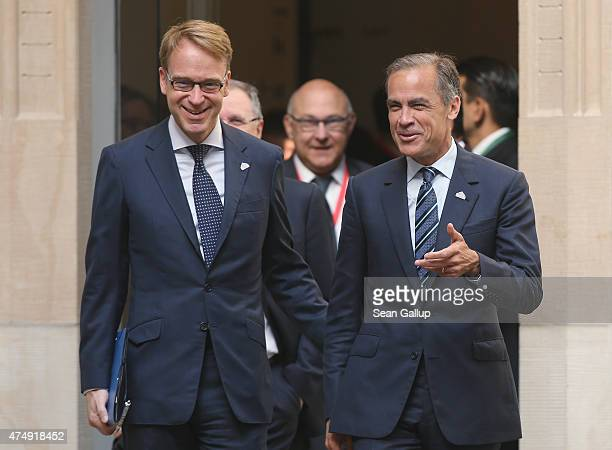 Jens Weidmann Governor of Germany's Bundesbank and Mark Carney Governor of the Bank of England arrive for a symposium during a meeting of finance...