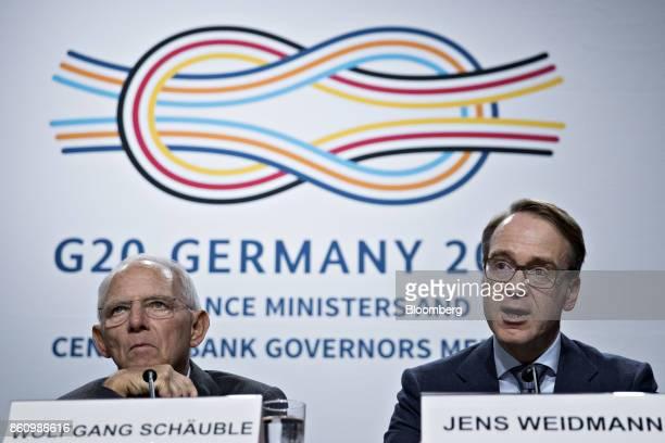 Jens Weidmann president of the Deutsche Bundesbank right speaks as Wolfgang Schaeuble Germany's finance minister listens during a Group of 20 finance...