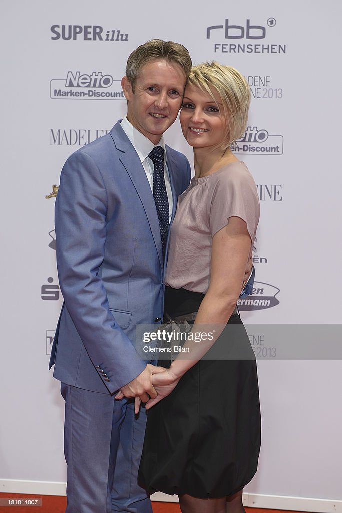 Jens Weissflog and Doreen Fiebig arrive for the Goldene Henne 2013 award at Stage Theater on September 25, 2013 in Berlin, Germany.