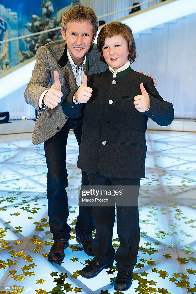 Jens Weissflog (L) and Florian Ritzer (R) pose for pictures after the 'Winterfest der fliegenden Stars' TV-Show on January 26, 2013 at the Freiheitshalle in in Hof, Germany.