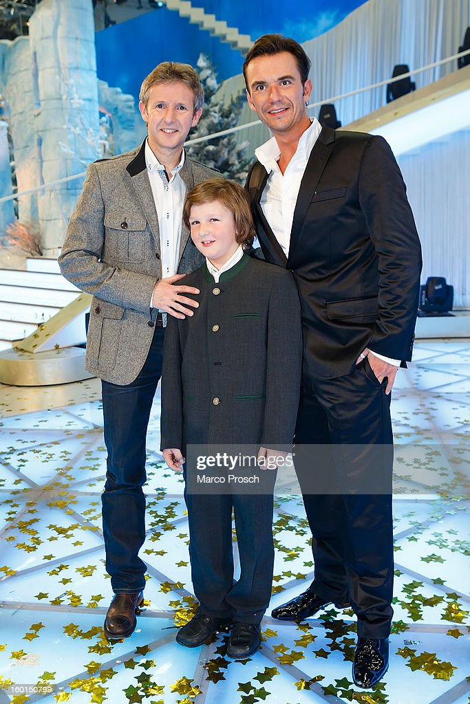 Jens Weissflog, Florian Ritzer and <a gi-track='captionPersonalityLinkClicked' href=/galleries/search?phrase=Florian+Silbereisen&family=editorial&specificpeople=2919730 ng-click='$event.stopPropagation()'>Florian Silbereisen</a> pose for pictures after the 'Winterfest der fliegenden Stars' TV-Show on January 26, 2013 at the Freiheitshalle in in Hof, Germany.
