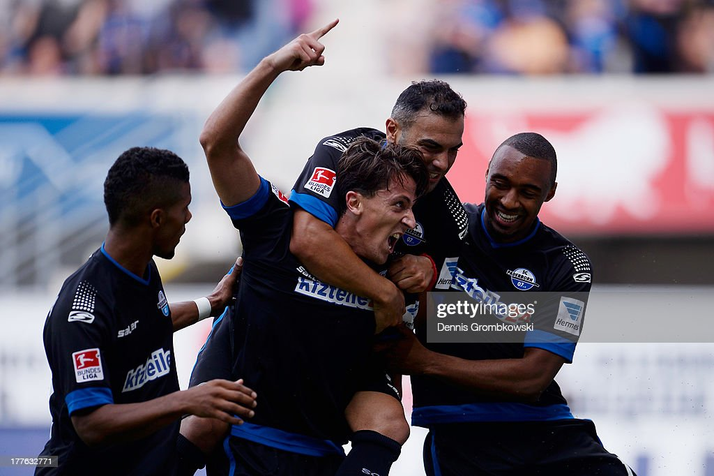 Jens Wemmer of SC Paderborn celebrates with teammates after heading his team's first goal during the Second Bundesliga match between SC Paderborn and...
