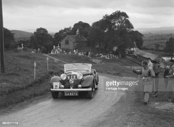 Jensen open 4seater of Ken Crawford competing in the South Wales Auto Club Welsh Rally 1937 Artist Bill Brunell Jensen Open 4seater 1937 3622 cc...