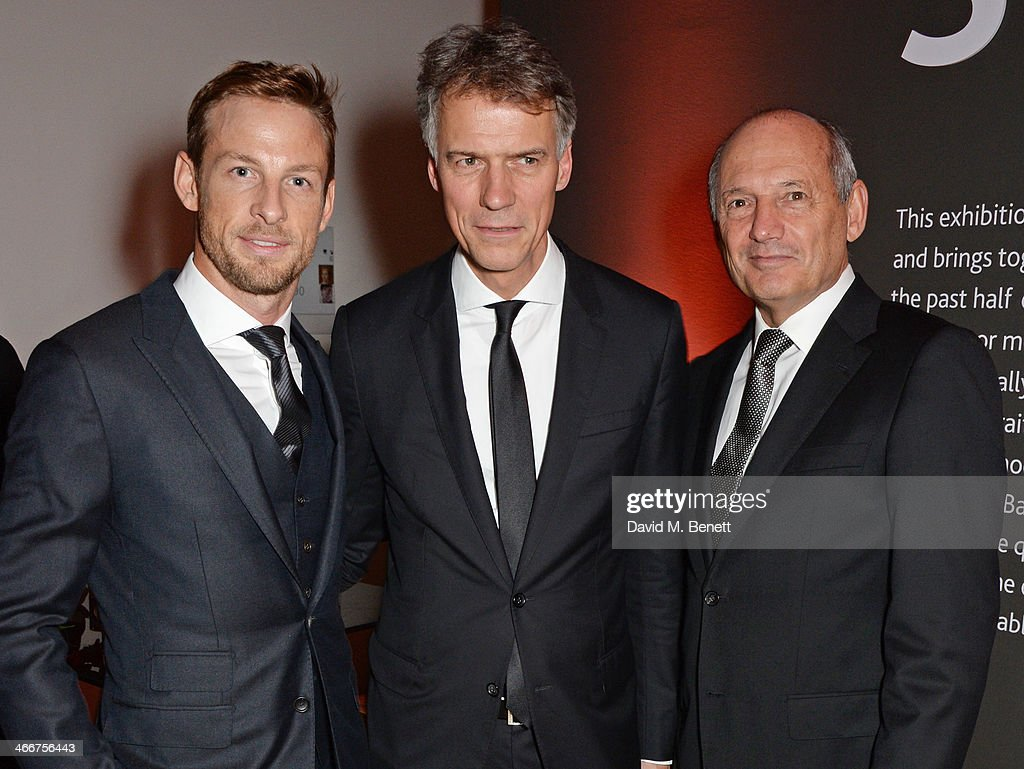 Jenson Button Hugo Boss AG CEO ClausDietrich Lahrs and Ron Dennis attend a private view of Bailey's Stardust a exhibition of images by David Bailey...