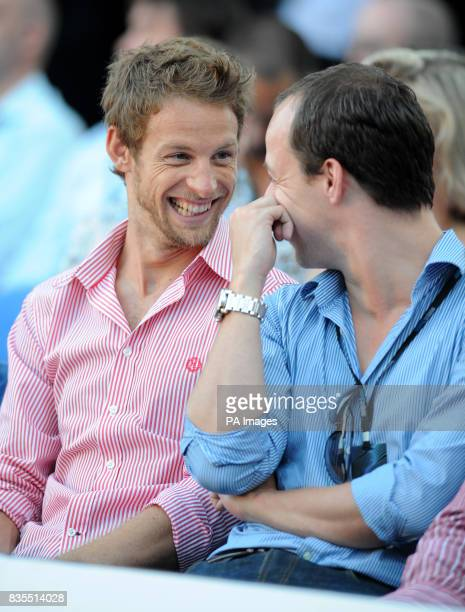 Jenson Button jokes with a friend during the Fashion Show at The Amber Lounge Le Meridien Beach Plaza Hotel Monaco