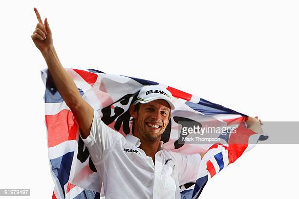 Jenson Button of Great Britain and Brawn GP celebrates clinching the F1 World Drivers Championship during the Brazilian Formula One Grand Prix at the...