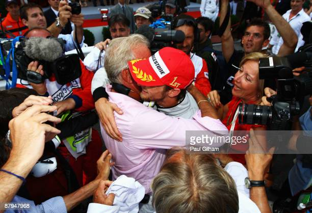 Jenson Button of Great Britain and Brawn GP celebrates with his father John Button after winning the Monaco Formula One Grand Prix at the Monte Carlo...