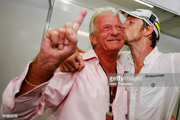 Jenson Button of Great Britain and Brawn GP celebrates with his father John Button after clinching the F1 World Drivers Championship during the...