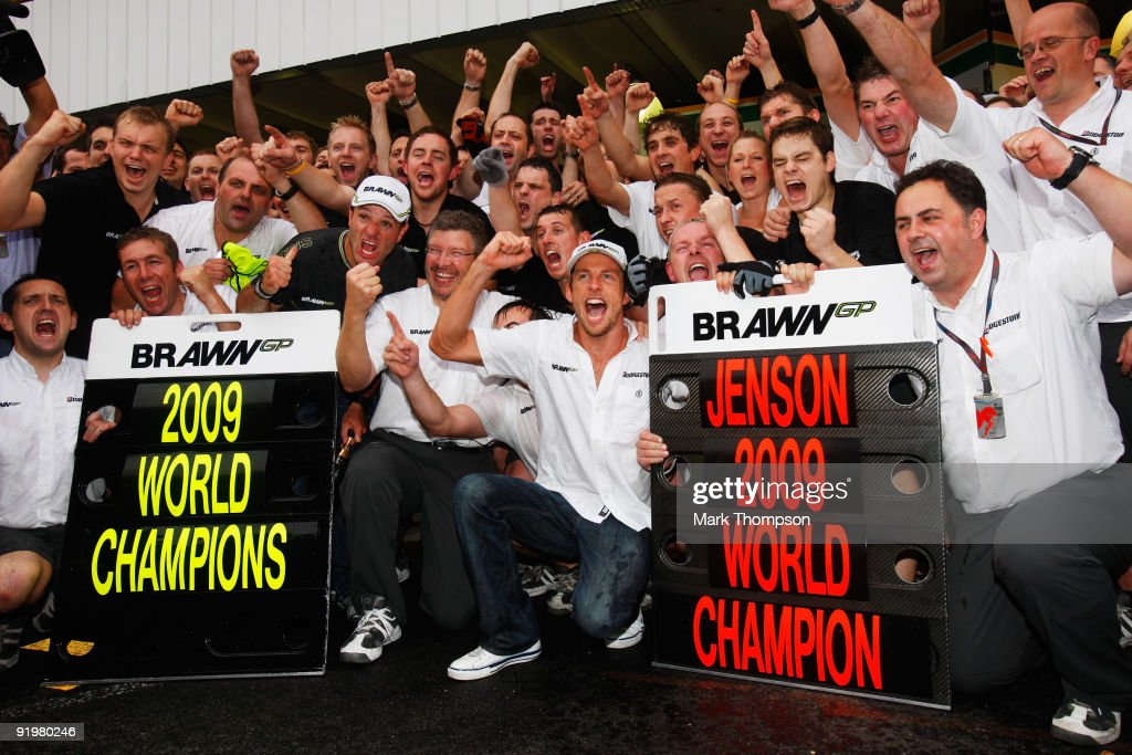 <a gi-track='captionPersonalityLinkClicked' href=/galleries/search?phrase=Jenson+Button&family=editorial&specificpeople=171505 ng-click='$event.stopPropagation()'>Jenson Button</a> (C) of Great Britain and Brawn GP celebrates with team mates as he wins the World Drivers Championship and Brawn GP win the Constructors Championship during the Brazilian Formula One Grand Prix at Interlagos Circuit on October 18, 2009 in Sao Paulo, Brazil.